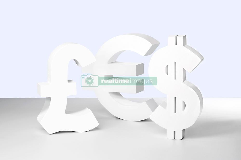 Dollar, Euro and Pound signs on white background (Credit Image: © Image Source/Howard Bartrop/Image Source/ZUMAPRESS.com)