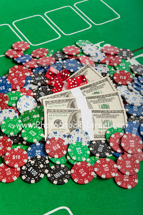 Money and Poker Chips on a green felt poke table