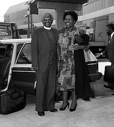 South Africa's Anglican Archbishop Desmond Tutu, with his wife Leah at Heathrow Airport after flying from Johannesburg, en route to Moscow.