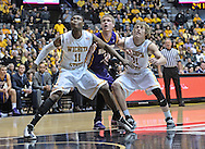 WICHITA, KS - JANUARY 05:  Players Cleanthony Early #11 and Ron Baker #31 of the Wichita State Shockers get set for a rebound against forward Nate Buss #14 of the Northern Iowa Panthers during the second half on January 5, 2014 at Charles Koch Arena in Wichita, Kansas.  (Photo by Peter G. Aiken/Getty Images) *** Local Caption *** Cleanthony Early;Ron Baker;Nate Buss