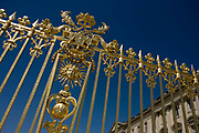 The golden gates of the Palace of Versaille, near Paris. Replicas of the original 80m wrought iron and gold leaf gates grace the entrance to Louix XVI's former power base. A total of 100,000 gold leaves were crafted into the shapes of fleur de lys, crowns, masks of Apollo, cornucopias and the crossed capital Ls representing the Sun King. Private donors contributed £4 million to rebuild the 15-ton work, and a plethora of historians and top craftsmen – sculptors, gilders, wrought iron craftsmen and ornament makers – were drafted in to ensure an exact replica of the original built by Jules Hardouin-Mansart in the 1680s. The Palace of Versailles or simply Versailles, is a royal château in Versailles in the Île-de-France region of France. In French it is the Château de Versailles.