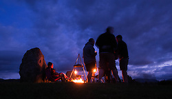 © Licensed to London News Pictures. <br /> 20/06/2014. <br /> <br /> Castlerigg Stone circle, Cumbria, England<br /> <br /> Visitors to the ancient site of Castlerigg Stone Circle near Keswick in Cumbria gather around a fire and start to celebrate on the evening of the Summer Solstice.<br /> <br /> Photo credit : Ian Forsyth/LNP