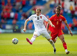 CARDIFF, WALES - Saturday, June 5, 2021: Albania's Ardian Ismajli (L) and Wales' Tyler Roberts during an International Friendly between Wales and Albania at the Cardiff City Stadium in their game before the UEFA Euro 2020 tournament. (Pic by David Rawcliffe/Propaganda)