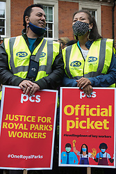PCS members attend a picket outside the Old Police House in Hyde Park for Royal Parks workers outsourced via French multinational VINCI Facilities as part of joint strike action by the United Voices of the World (UVW) and Public and Commercial Services (PCS) trade unions on 30th July 2021 in London, United Kingdom. The joint strike, with members dual carding over pay, conditions and the sacking of a member of staff, is believed to be the first between a TUC and a non-TUC trade union and follows the launch of a legal challenge by the Royal Parks workers against indirect racial discrimination by the Royal Parks.
