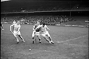10/09/1967<br /> 09/10/1967<br /> 10 September 1967<br /> Under-21 Hurling Final: Dublin v Tipperary at Croke Park, Dublin.<br /> A Tipperary forward being tackled by two Dublin backs.