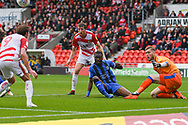 Gabriel Zakuani of Gillingham (6) makes a crucial clearance as Tomáš Holý of Gillingham (1) is stranded, and Tom Anderson of Doncaster Rovers (12) and John Marquis of Doncaster Rovers (9) are ready to pounce on a loose ball during the EFL Sky Bet League 1 match between Doncaster Rovers and Gillingham at the Keepmoat Stadium, Doncaster, England on 20 October 2018.