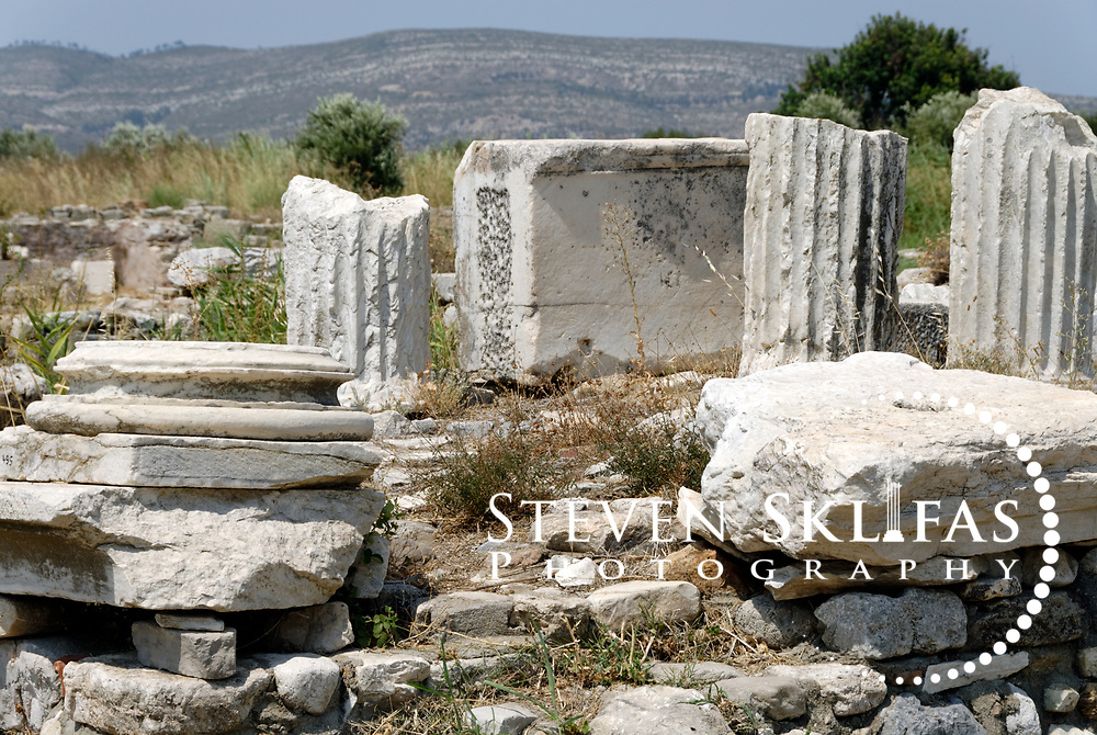 Iraion. Samos. Greece. View of some abandoned column drums and capitals amongst the ruins of the precinct of Heraion. Heraion is the main sanctuary of ancient Samos and is located on the southeast coast, 6 km kilometres from Pythagoreio.