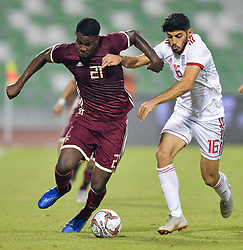 Mehdi Torabi (R) of Iran vies for the ball with Sergio Cordov (L) of Venezuela during the international friendly soccer match between Iran and Venezuela at Al Ahli Stadium Doha, Capital of Qatar, November 20, 2018. The match ended with a 1-1 draw. (Credit Image: © Nikku/Xinhua via ZUMA Wire)