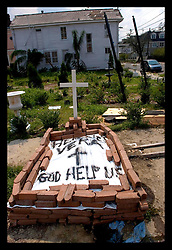 5th Sept, 2005. Hurricane Katrina aftermath. New Orleans. 'Here lies Vera - God help us.' The temporary grave of a resident of Uptown New Orleans lies at the crossroads of Magazine Street and Jackson Street in the ghost town that once was New Orleans.