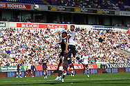 Gary Madine of Bolton Wanderers heads above Ryan Shotton of Derby County but sees his effort hit the crossbar.  Skybet football league championship match, Bolton Wanderers v Derby County at the Macron stadium in Bolton, Lancs on Saturday 8th August 2015.<br /> pic by Chris Stading, Andrew Orchard sports photography.