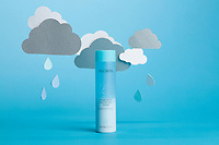 Product on a blue background with hanging clouds and raindrops