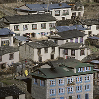 NEPAL, HIMALAYA. Leading Sherpa town Namche Bazaar, houses & lodges (fgnd.).