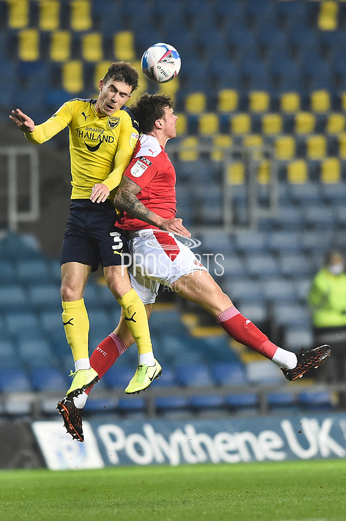 Oxford United defender Josh Ruffels (3) and Swindon Twn defender Tomas Broadbend (33) battles for possession  during the EFL Sky Bet League 1 match between Oxford United and Swindon Town at the Kassam Stadium, Oxford, England on 28 November 2020.