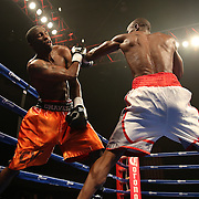 """Cecil McCalla (white shorts) beats Antonio Fernandes during the undercard of the ESPN """"Boxcino"""" boxing tournament at Turning Stone Resort Casino on Friday, April 18, 2014 in Verona, New York.  (AP Photo/Alex Menendez)"""