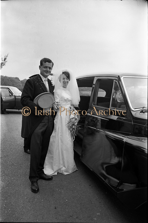 05/07/1967<br /> 07/05/1967<br /> 05 July 1967<br /> Wedding of George Walsh, eldest son of Mr and Ms Kevin G. Walsh, St. Rita's, Firhouse Road, Templeogue, Co. Dublin and Miss Arlene McMahon, elder daughter of Det. Chief Supt. Philip McMahon, Head of Special Branch, Dublin Castle and Mrs McMahon of Lisieux, Templeville Park, Templeogue, Co. Dublin who were married at the Carmelite Church, Terenure College, Dublin. An Taoiseach Mr Jack Lynch and Mrs Lynch; Mr Liam Cosgrave, leader Fine Gael and Mrs Cosgrave were among the 120 guests. Rev Fr H.E. Wright, O. Carm., Moate, officiated at the ceremony. The reception was held at Downshire Hotel, Blessington, Co. Wicklow. The couple pictured beside the wedding car after the ceremony.