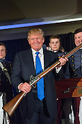 Billionaire and GOP Presidential hopeful Donald Trump holds up a replica flintlock rifle award him by cadets during the Republican Society Patriot Dinner at the Citadel Military College February 22, 2015 in Charleston, South Carolina. Trump and Senator Tim Scott were honored at the annual event.