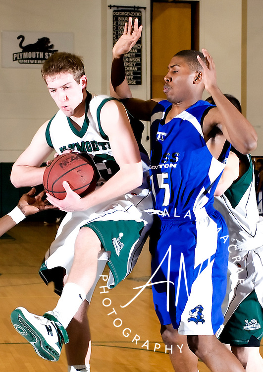 Plymouth State's Jason O'Keefe snares a rebound away from UMass Boston's Kenneth Hite, Jr. during Saturday's game at PSU.  (Alan MacRae/for the Citizen)