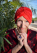 """Midtown resident, Susan Lewis, 63, says, """"I try to feel love and compassion for people because they need it.  We all need it.  Plus, it is Sunday.  It is church day"""", in Tucson, Arizona, USA."""