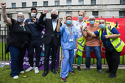 John McDonnell (c), Labour MP for Hayes and Harlington, joins NHS workers and supporters at a protest rally opposite Downing Street as part of a national day of action to mark the 73rd birthday of the National Health Service on 3rd July 2021 in London, United Kingdom. The protesters called for fair pay for NHS workers, for better funding of the NHS and for an end to privatisation measures affecting the NHS.