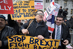 © Licensed to London News Pictures. 05/12/2016. London, UK. An anti Brexit protestor stands outside the Supreme Court in Westminster, London on the first day of a Supreme Court hearing to appeal against a November 3 High Court ruling that Article 50 cannot be triggered without a vote in Parliament. Photo credit: Peter Macdiarmid/LNP