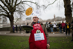 © Licensed to London News Pictures. 13/02/2018. London, UK. James Landale of the Media team practise ahead of the Rehab Parliamentary Pancake Race 2018 in Victoria Tower Gardens. The Parliament Team - made up of MPs, Lords and Ladies - race in a relay against the Media Team - made up of reporters and presenters - whilst continuously flipping pancakes to celebrate Shrove Tuesday, also known as Pancake Day. Photo credit : Tom Nicholson/LNP
