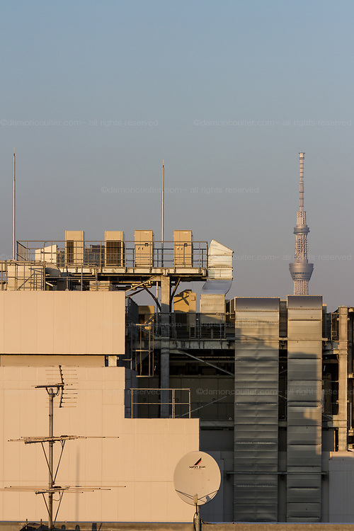 Tokyo Skytree seen behind air conditioning vents and equipment. Ginza, Tokyo, Japan. Friday October 27th 2017