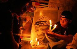 Palestinians start a vigil for Yasser Arafat after news spread that he was suffering from a brain hemorrhage, Gaza, Palestinian Territories, Nov. 9, 2004. Residents of Gaza say they are in shock from the news of Arafat's deteriorating condition. Arafat remains in critical condition in a Paris hospital.
