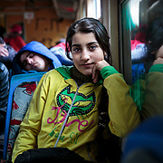 """Maram, 13, a refugee from Daraa, Syria, is about to depart by train with her family from Presevo, Serbia, to the Croatian border in January 2016. From there, they will continue on to Germany. """"The people in Greece were so nice to us, but the journey has been very exhausting, and the boats were very scary. Now we are going to Germany, and we will study and learn the language. And we will stay there and hope for a happy life."""""""