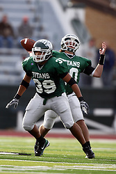 12 November 2011:  Sean Conley provides pass protection for Rob Gallik during an NCAA division 3 football game between the Augustana Vikings and the Illinois Wesleyan Titans in Tucci Stadium on Wilder Field, Bloomington IL
