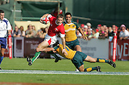 Jason Tovey of Wales is tackled. IRB Emirates airline Dubai sevens 2008. match 10 action, Pool A Wales v Australia at the Sevens Stadium in Dubai on Friday 28th November 2008..pic by Andrew Orchard.