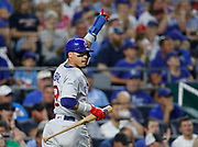 Chicago Cubs' Javier Baez reacts after scoring off a David Bote single in the fifth inning of a baseball game against the Kansas City Royals at Kauffman Stadium in Kansas City, Mo., Tuesday, Aug. 7, 2018. (AP Photo/Colin E. Braley)