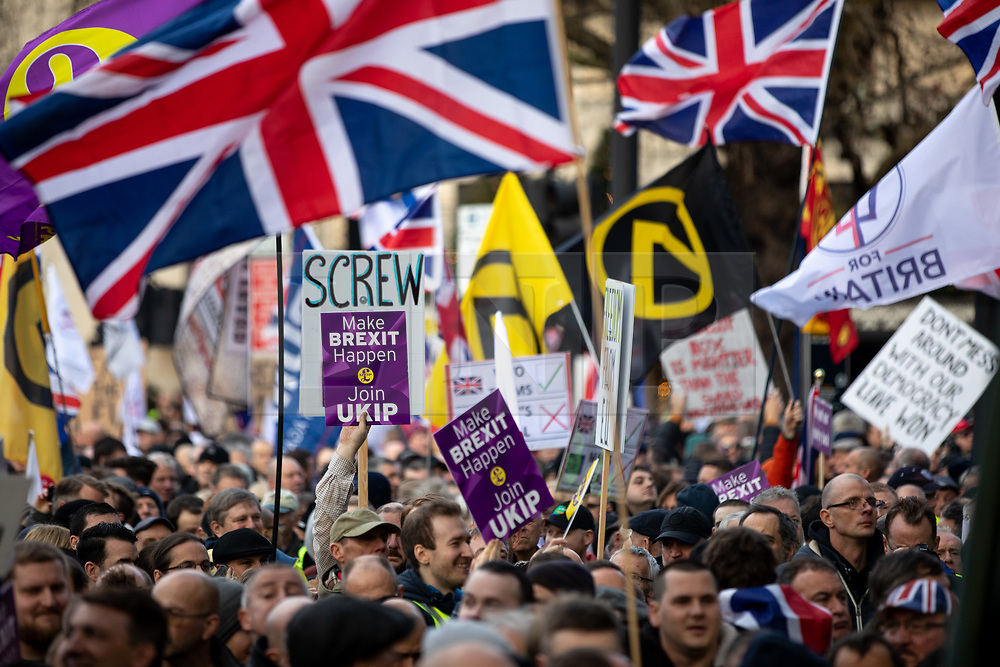 © Licensed to London News Pictures. 09/12/2018. London, UK. Demonstrators take part in a 'Brexit Betrayal' march in central London, campaigning against Theresa May's Brexit deal. The demonstration is backed and attended by political activist Stephen Yaxley-Lennon, also known as Tommy Robinson. A counter demonstration organised by Unite Against Fascism and Racism is also taking place on a different route. Photo credit : Tom Nicholson/LNP