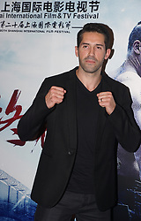 June 22, 2017 - Shanghai, Shanghai, China - Shanghai, CHINA-June 22 2017: (EDITORIAL USE ONLY. CHINA OUT) Scott Adkins imitates classic pose of Bruce Lee...Actor Scott Adkins attends the press conference of the movie Boyka: Undisputed IV at the 20th Shanghai International Film Festival in Shanghai, June 22nd, 2017. (Credit Image: © SIPA Asia via ZUMA Wire)