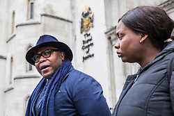 © Licensed to London News Pictures. 23/02/2018. London, UK. Lanre Haastrup (L) speaks outside the High Court in London alongside his wife, Takesha Thomas (R) after judges ruled that doctors at King's College Hospital can withdraw life support for his son,11-month-old  Isaiah Haastrup, who has suffered severe brain damage. Photo credit: Rob Pinney/LNP