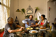 Bejoy George, IT consulatant, wife, Bina and mother sits down for an early morning breakfast before he heads to work, Bangalore, India