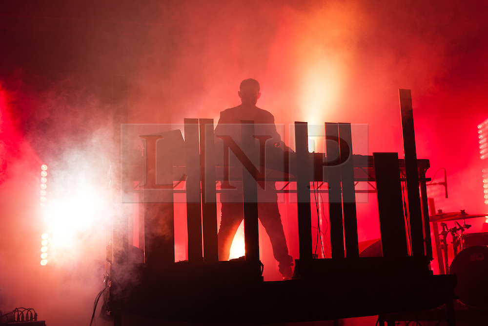 © Licensed to London News Pictures. 30/08/2015. Reading, UK. Hudson Mohawke performing at Reading Festival 2015, Day 3 Sunday.  Hudson Mohawke is Ross Birchard.  Photo credit: Richard Isaac/LNP