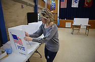 Dina Sebold of Churchville, Pa. cleans the voting area with sanitizer during a special election Tuesday, March 17, 2020 at Snyder Middle School in Bensalem, . (WILLIAM THOMAS CAIN/PHOTOJOURNALIST)