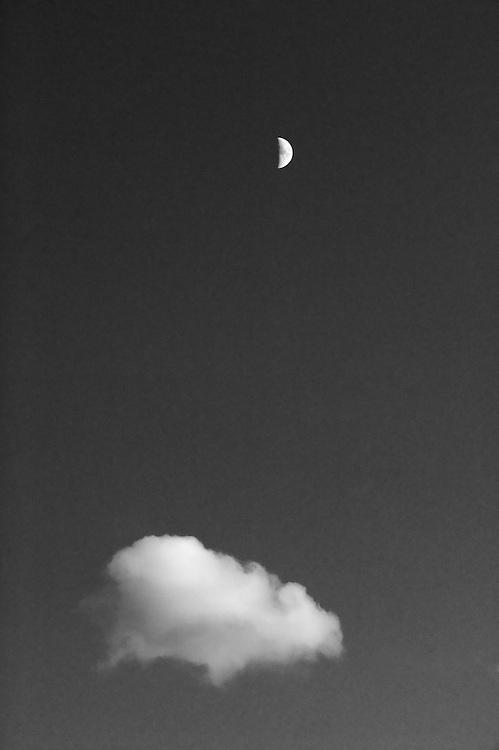 IFTE-NB-007864; Niall Benvie; Half moon and cloud; Europe; Austria; Tirol; heavens; vertical; high above remote distant; black white; sky; 2008; July; summer; dusk evening; Wild Wonders of Europe Naturpark Kaunergrat