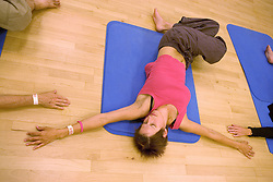 Woman taking part in a yoga class at Southglade Leisure Centre; Nottingham