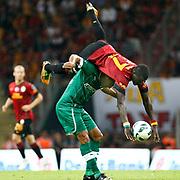 Galatasaray's Emmanuel Eboue and Bursaspor's Gokcek Vederson (down) during their Turkish Super League soccer match Galatasaray between Bursaspor at the TT Arena at Seyrantepe in Istanbul Turkey on Sunday 02 September 2012. Photo by TURKPIX