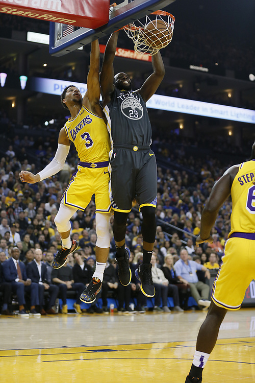 Golden State Warriors forward Draymond Green (23) dunks against Los Angeles Lakers guard Josh Hart (3)  in the first half of an NBA game at Oracle Arena on Saturday, Feb. 2, 2019, in Oakland, Calif.
