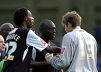 Photo: Olly Greenwood.<br />Gillingham v Swansea City. Coca Cola League 1. 16/09/2006. Swansea's Adebayo Akinfenwa is stopped from confronting Gillingham's Scott Flinders by Dennis Lawrence after his goal is disallowed.