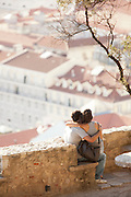 People gather to see the view and watch the sunset over Lisbon from the Castle of Sao Jorge, Portugal