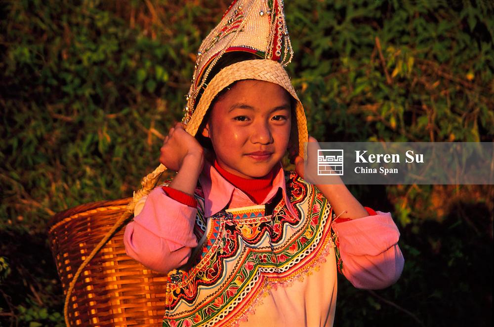 Hani girl carrying basket, Yuanyang, Yunnan, China