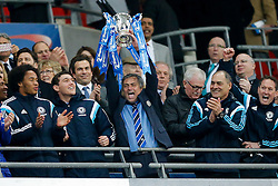 Chelsea Manager Jose Mourinho lifts the League Cup trophy after winning the Capital One Cup Final - Photo mandatory by-line: Rogan Thomson/JMP - 07966 386802 - 01/03/2015 - SPORT - FOOTBALL - London, England - Wembley Stadium - Chelsea v Tottenham Hotspur - Capital One Cup Final.