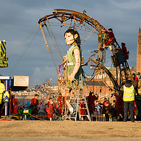 LIVERPOOL, UK, 20th April, 2012. The Sea Odyssey. The little girl giant walks around Kings Dock.