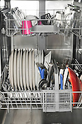 Dishwasher stacked with dishes