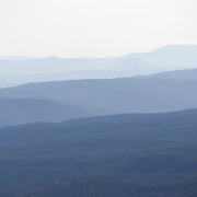Lines of mountain ridges disappear into the distance in the Blue Mountains as seen from Echo Point in Katoomba, New South Wales, Australia.