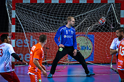 The Dutch handball player Bart Ravensbergen in action during the European Championship qualifying match against Turkey in the Topsport Center Almere.