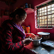 Gudiya Khan cooks in her kitchen on Dec. 4, 2018, built with what she has earned from knitting, shared with her sister-in-law.